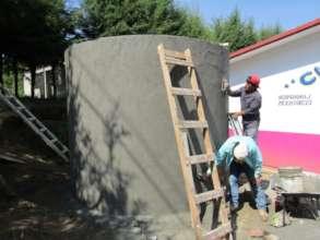 Finishing up cistern at S.J. Zitacuaro community