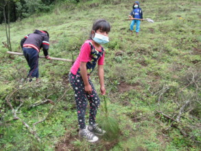 Girl from N. Romero community planting a tree