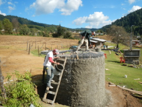 Men from Rosario finish cistern to hold rain-water