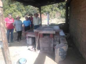 Family with completed fuel-efficient stove