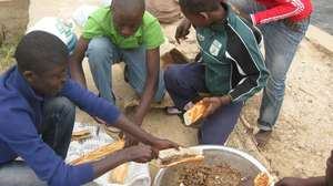 Talibe Kalidou Balde helps prepare the meal