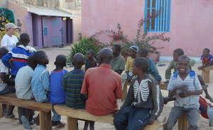 Teaching outdoor class in MDG center