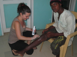 Caring for a talibe in MDG infirmary