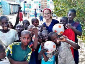 Savannah with soccer balls she donated