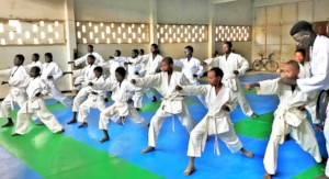Buaro guides talibe students in class at the dojo