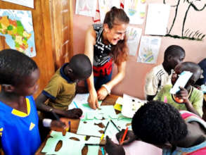 Joy drawing with younger talibe children