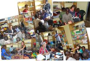 Volunteers teaching talibe children in MDG library