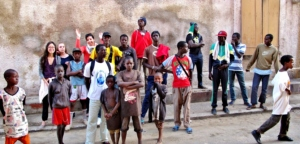 Children and volunteers gather ...