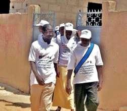 Mamadou (right) and Idrissa lead door-to-door team