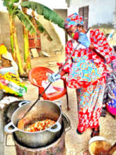 A Godmother cooking for the talibes