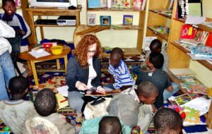 Sonia reading with talibe children in the library