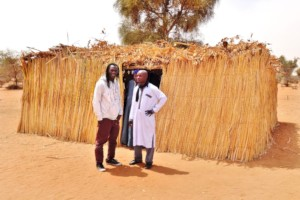 Issa and Cheikh outside the school in Thiagale