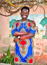 Instructor Baka modelling a talibe-made outfit