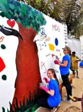 ... painting a beautiful mural outside the center