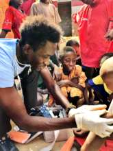 Treating a child, many others waiting