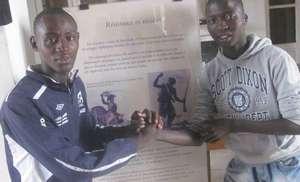 Arouna with Kalidou, studying history of slavery