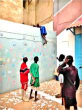 Tiny talibe disappears over 8-ft wall, after ball