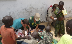 Volunteers care for talibe children in a daara