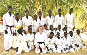 Buaro & Sonia with students at a MDG morning class