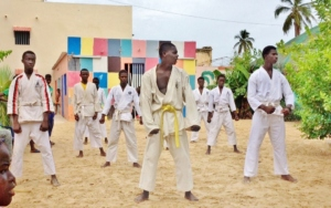 Now a yellow belt, leading the karate class at MDG