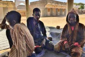 Moustapha with two other boys in the daara