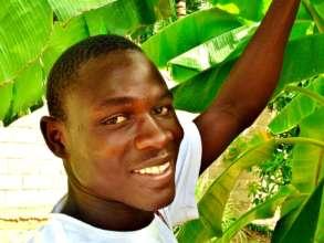 Mamadou with thriving Bango banana trees