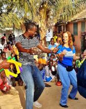 Rachel Lapierre dansing with MDG teacher Abdou
