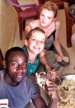 Author Arouna eats Senegalese-style with students