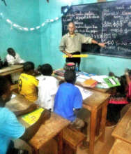 Teaching talibes students in an evening class