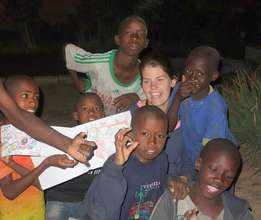 Talibe children proudly display their drawings