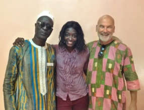 """Christoph wearing his """"boubou"""" with Aby and Ndaraw"""