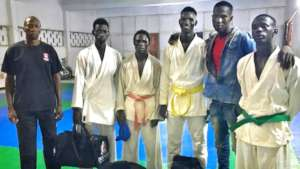 Issa (smiling) with Sor-Karate competition team