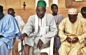 Religious leaders listen to the group in Sagna