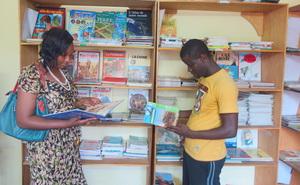 Teacher Bouri and librarian Bachir study new books