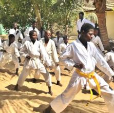 Black-belt Buaro leading a karate class at MDG