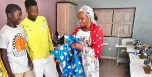 Mamadou & Kalidou deliver dress to happy customer