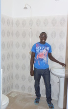 Mamadou admires one of the three new washrooms