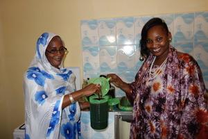 Teachers Aida, Bouri prepare juice in new kitchen