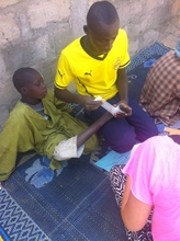 Talibe Arouna cares for other children in a daara