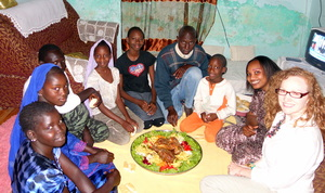 At dinner with teacher Bouri Mbodj and her family