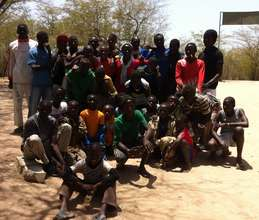 The talibes happily gather for a photo souvenir
