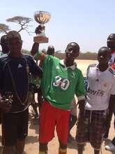 Lamine, team captain, proudly hoists the trophy