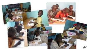 Talibes children color intently - a new experience