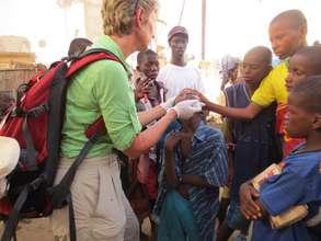 Karen Hornby treating talibe child's eye infection