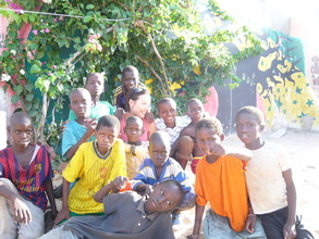 Jenny with tallibe children in MDG's center