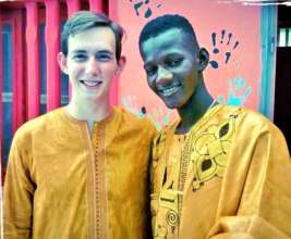 Sam and Iman in traditional Senegalese dress
