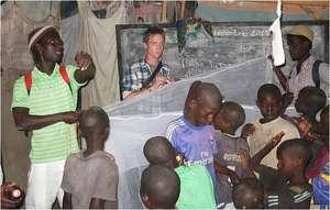 Issa organizing mosquito net installation in daara