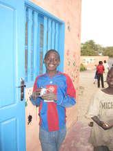 Promising talibe student Djibi, outside classroom