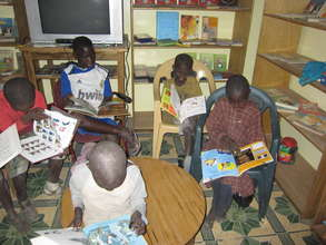 Talibes students reading in resource centre