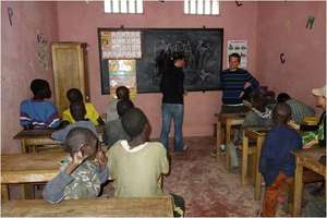 Teaching a senior French class, in MDG's centre